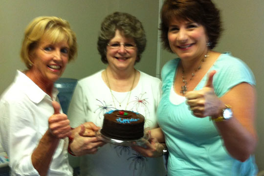 Group Photo with Cake - Thumbs Up
