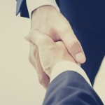 Handshake of businessmen in vintage (retro) color effect - success, congratulation, greeting & business partner concepts